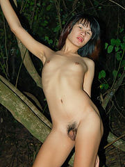 Unabashed ladyboy Gold posing all naked alfresco