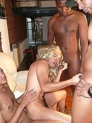 Cute Latin boy in curly wig gets fucked by three hung black studs and takes a mouthful of cum