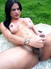 Raven haired shemale blowing her cumload