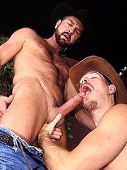 A well built cowboy deepthroats his partner while you watch