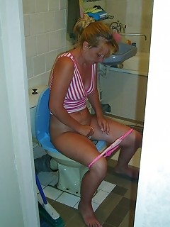 Amateurs Milfs and Teens spied on in the toilet