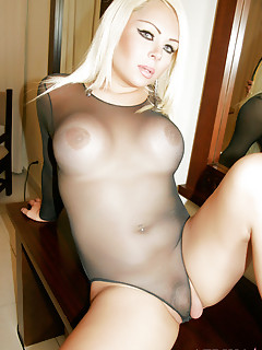 Blonde tranny in bodystockings shows off her boobs